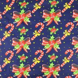Bawełna wzór świąteczny kokardki i laski na granatowym tle