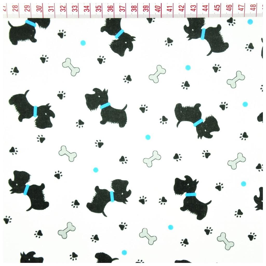 Tkanina w pieski czarne z kostkami na białym tle