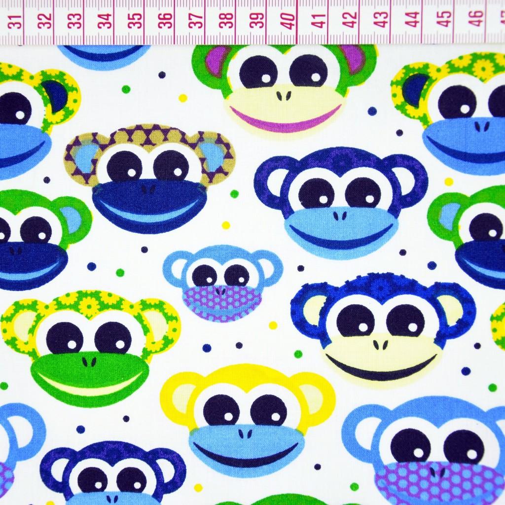 Tkanina w małpki zielono niebieskie na białym tle