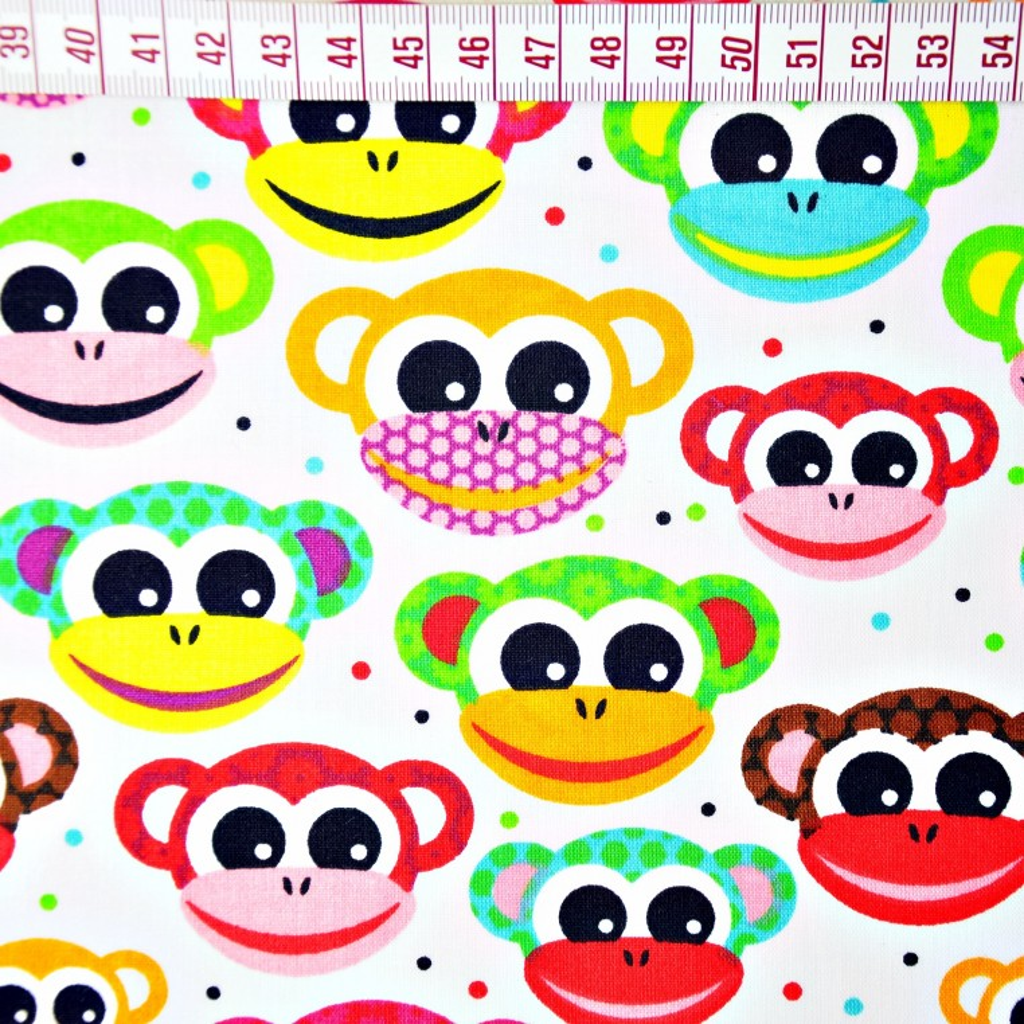 Tkanina w małpki czerwono żółte na białym tle