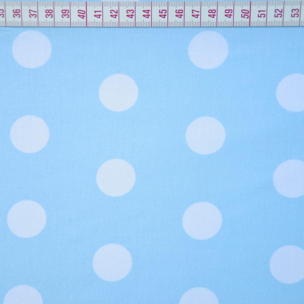 Tkanina w grochy duże białe na niebieskim tle
