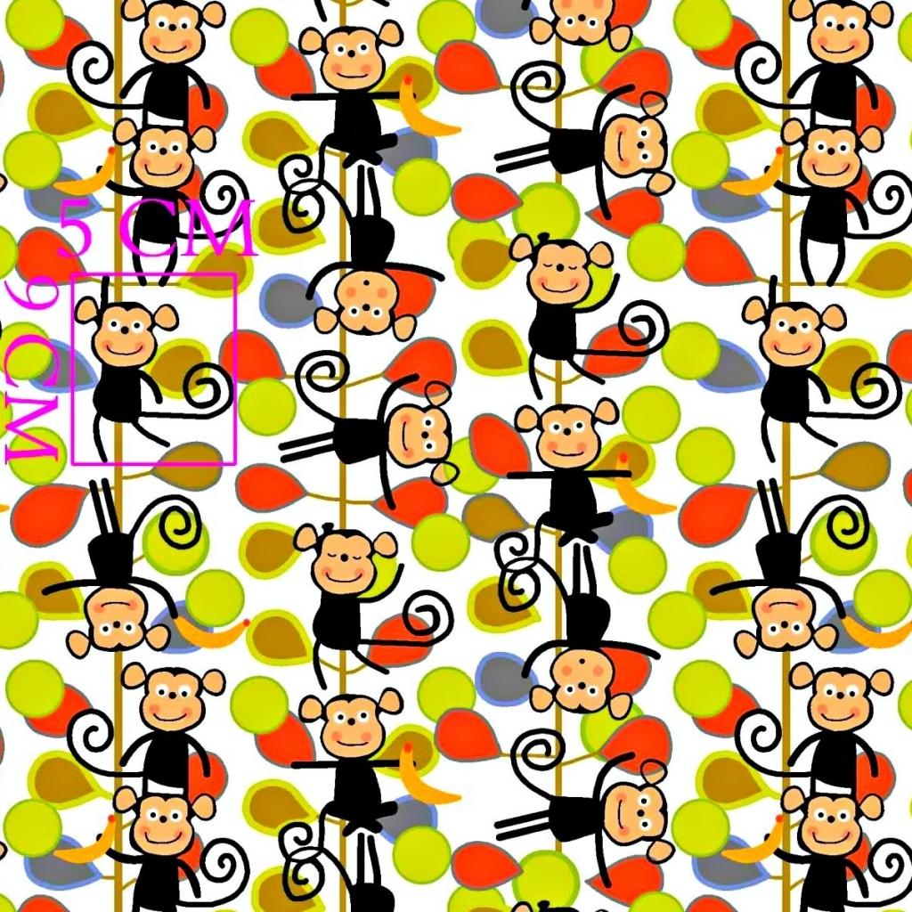 Tkanina w małpki zielono czerwone na białym tle