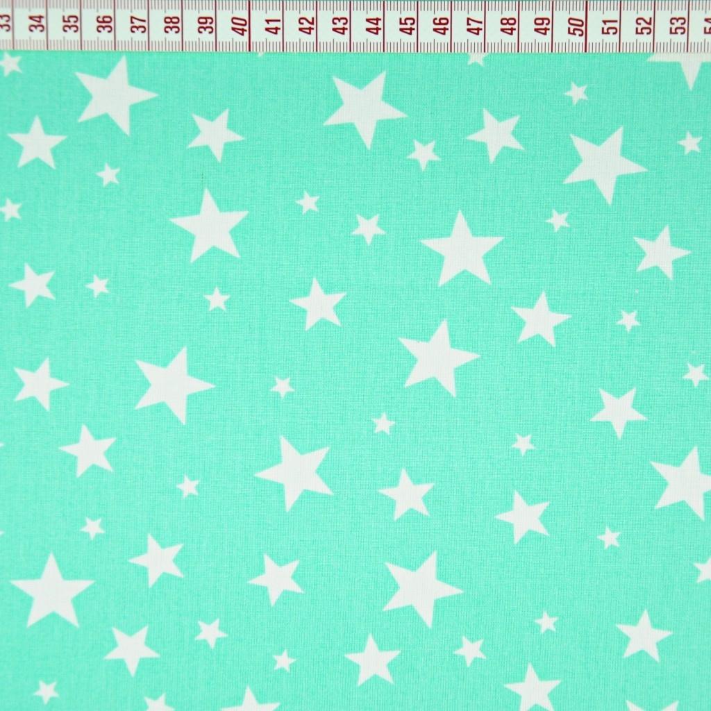 Tkanina w gwiazdki małe i duże na miętowym tle