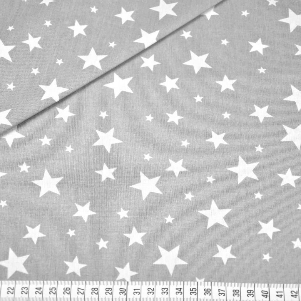 Tkanina w gwiazdki nowe małe i duże białe na szarym