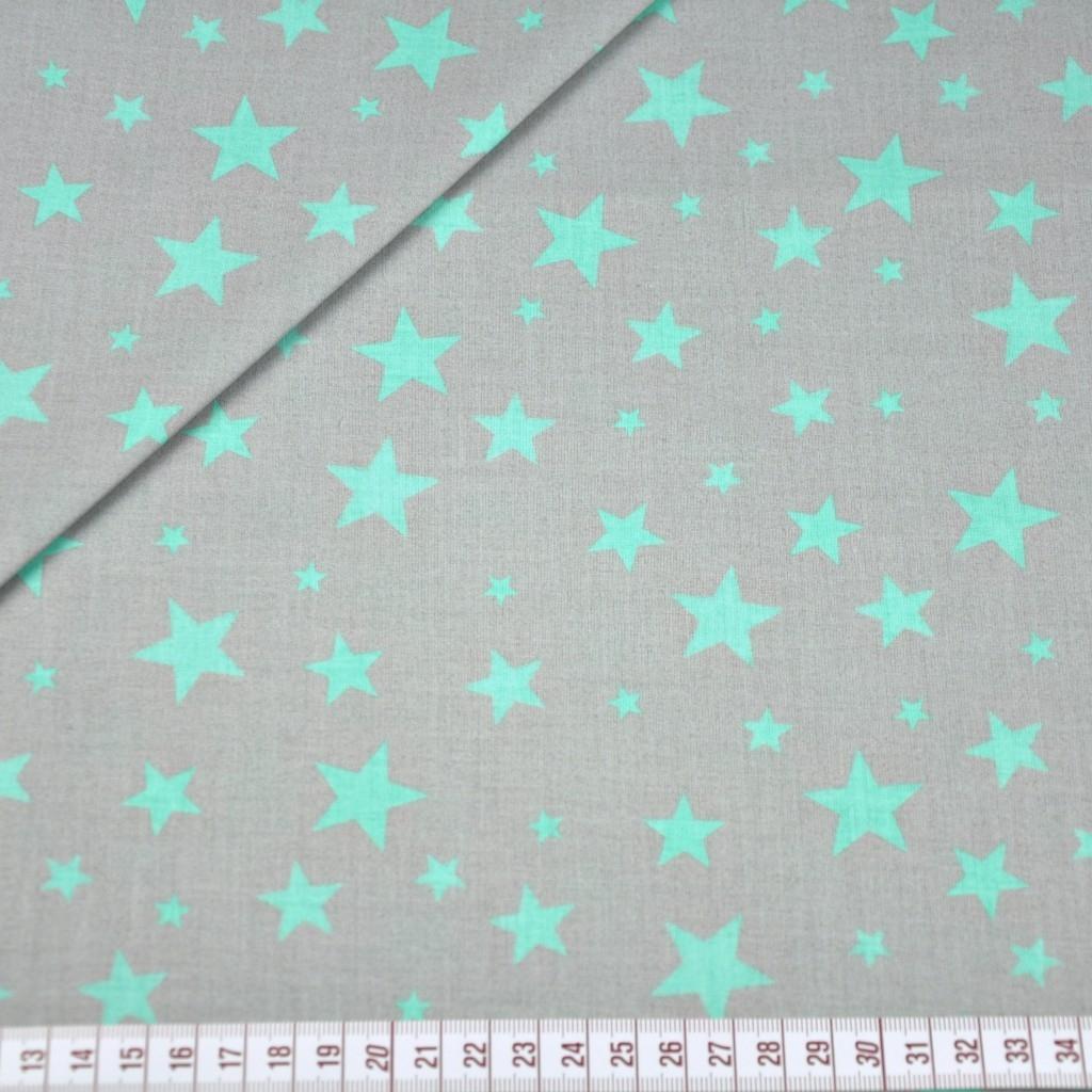 Tkanina w gwiazdki nowe małe i duże miętowe na szarym