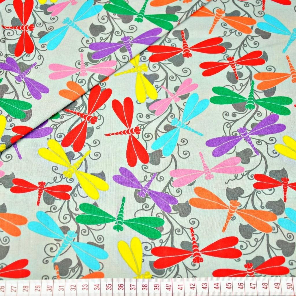 Tkanina w ważki kolorowe na szarym tle