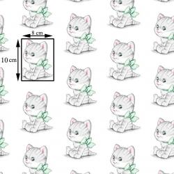 Tkanina w kotki szare z zielonymi kokardkami na białym tle