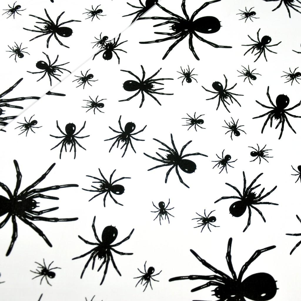 Tkanina w pajączki czarne na białym tle