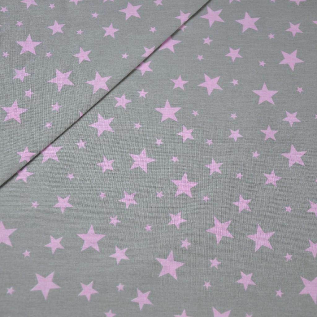 Tkanina w gwiazdki nowe małe i duże różowe na szarym