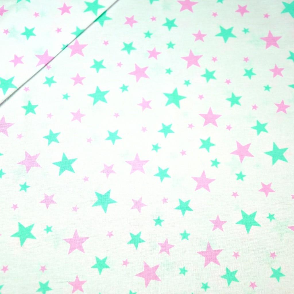 Tkanina w gwiazdki nowe małe i duże różowo miętowe na białym tle