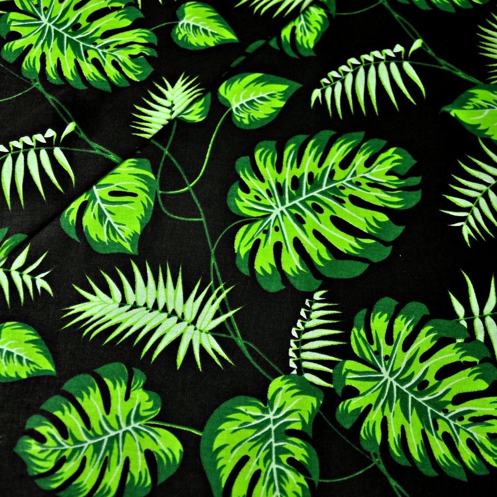 Tkanina w liście zielone na czarnym tle