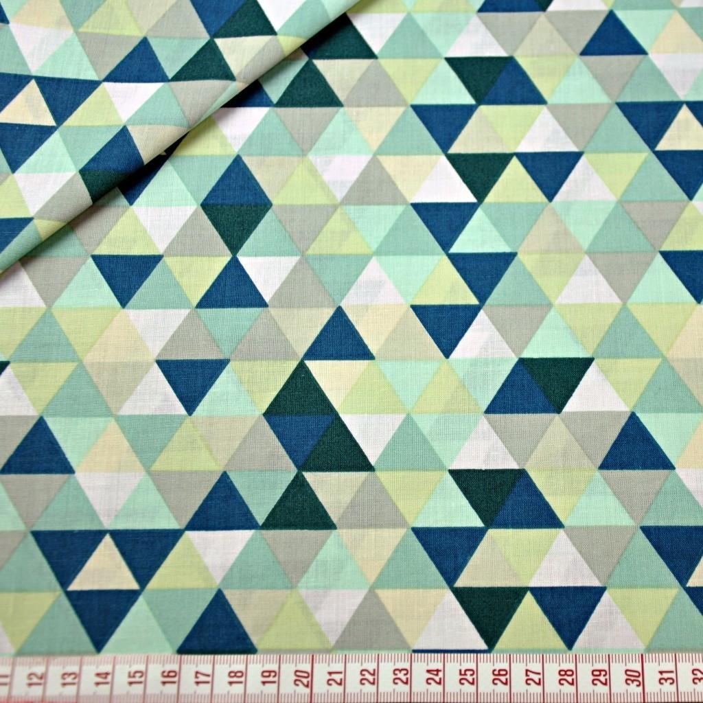 Tkanina w trójkąty małe kolorowe zielone na białym tle