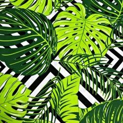 Tkanina w liście zielone na czarnych rombach na białym tle