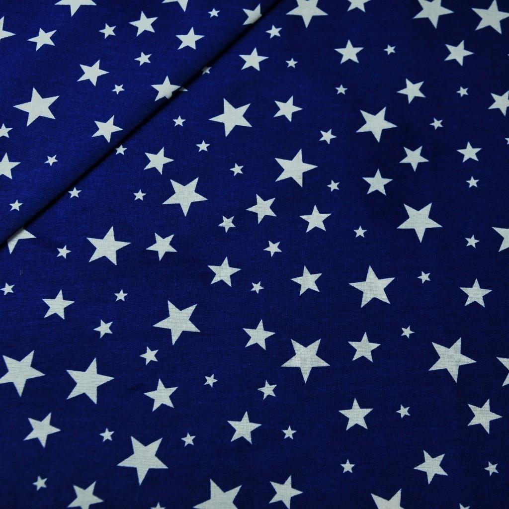 Tkanina w gwiazdki nowe małe i duże białe na granatowym tle