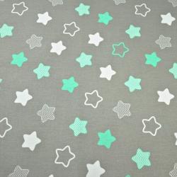 Tkanina w gwiazdki piernikowe biało miętowe na szarym tle