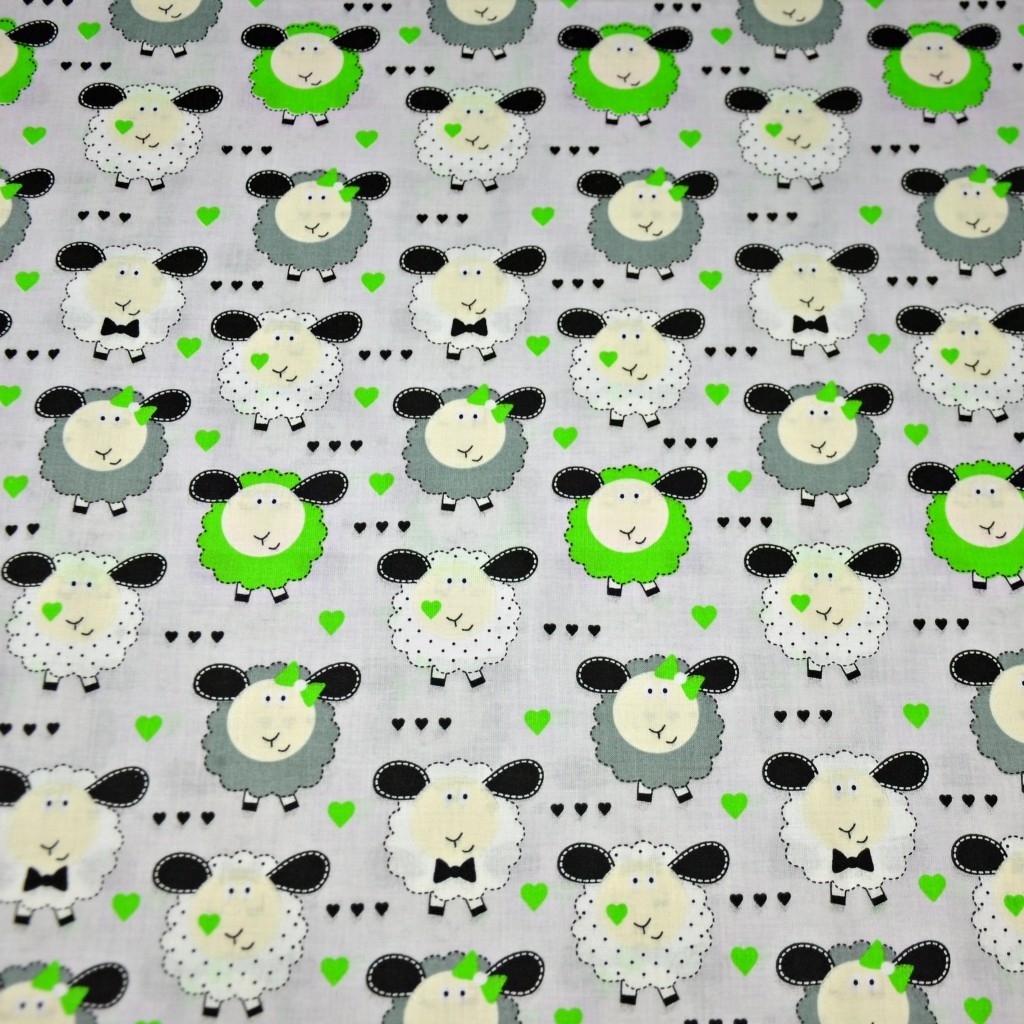 Tkanina owieczki zielono białe na szarym tle