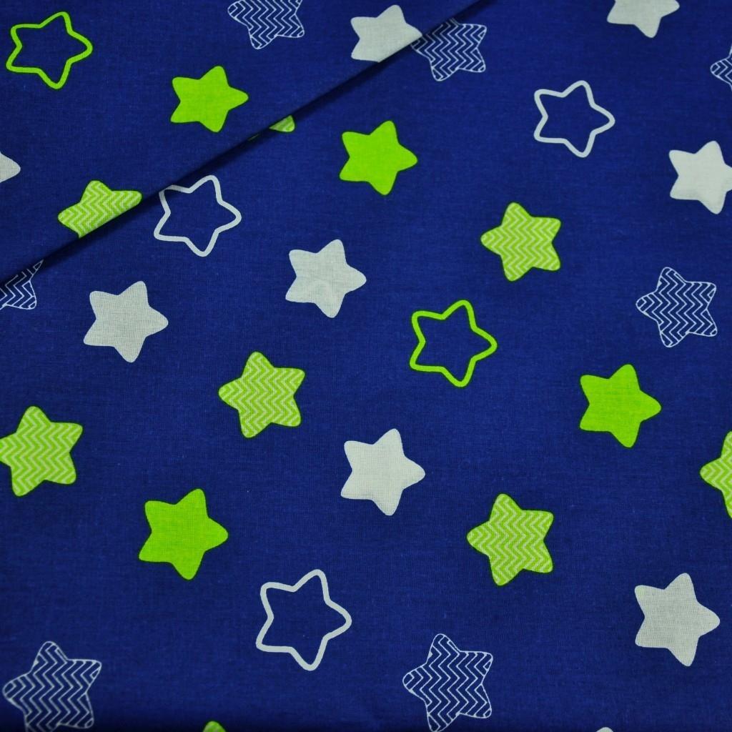 Tkanina w gwiazdki piernikowe biało limonkowe na granatowym tle