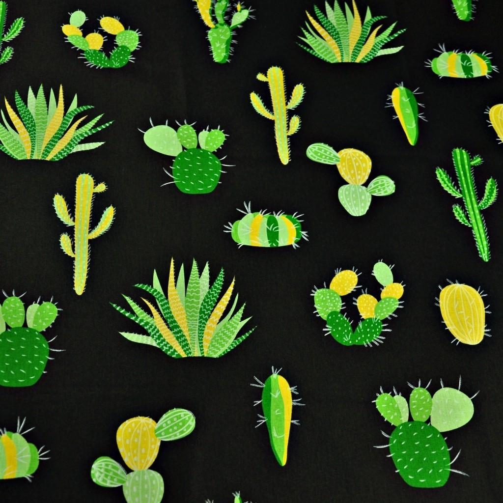 Tkanina w kaktusy zielone na czarnym tle