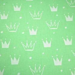 Tkanina w korony z kropkami białe na zielonym tle