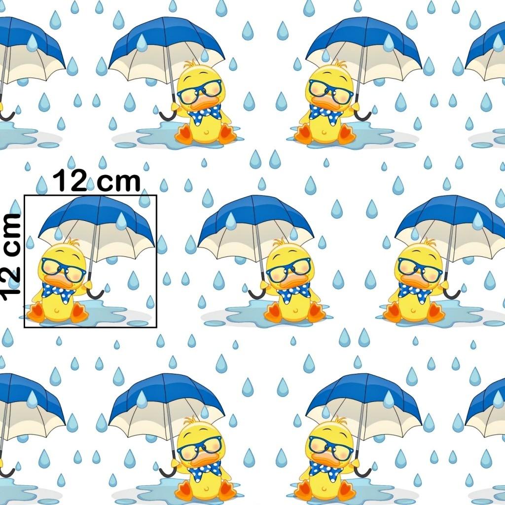 Tkanina w kaczuszki z niebieskim parasolem na białym tle