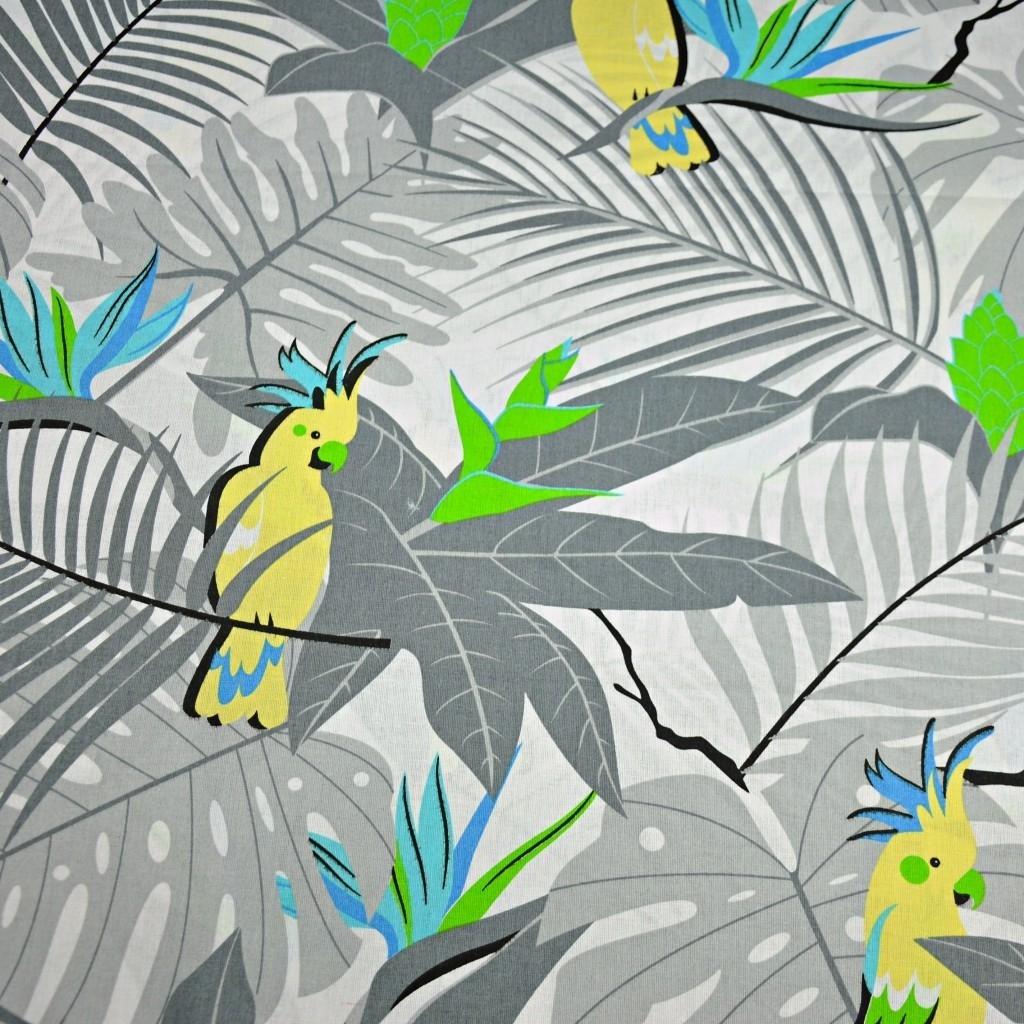 Tkanina w papugi żółte na szarych liściach