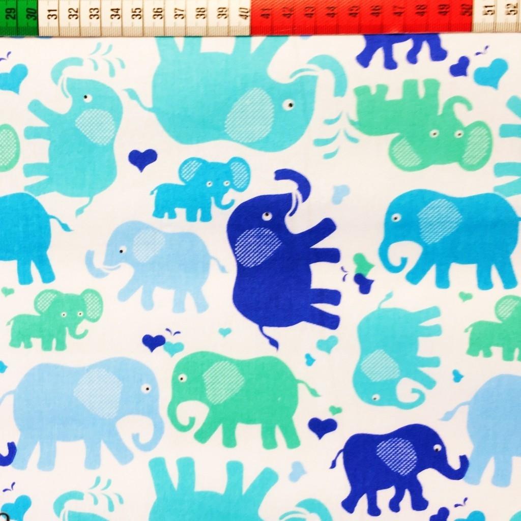 Tkanina w Słonie niebieskie i zielone na białym tle