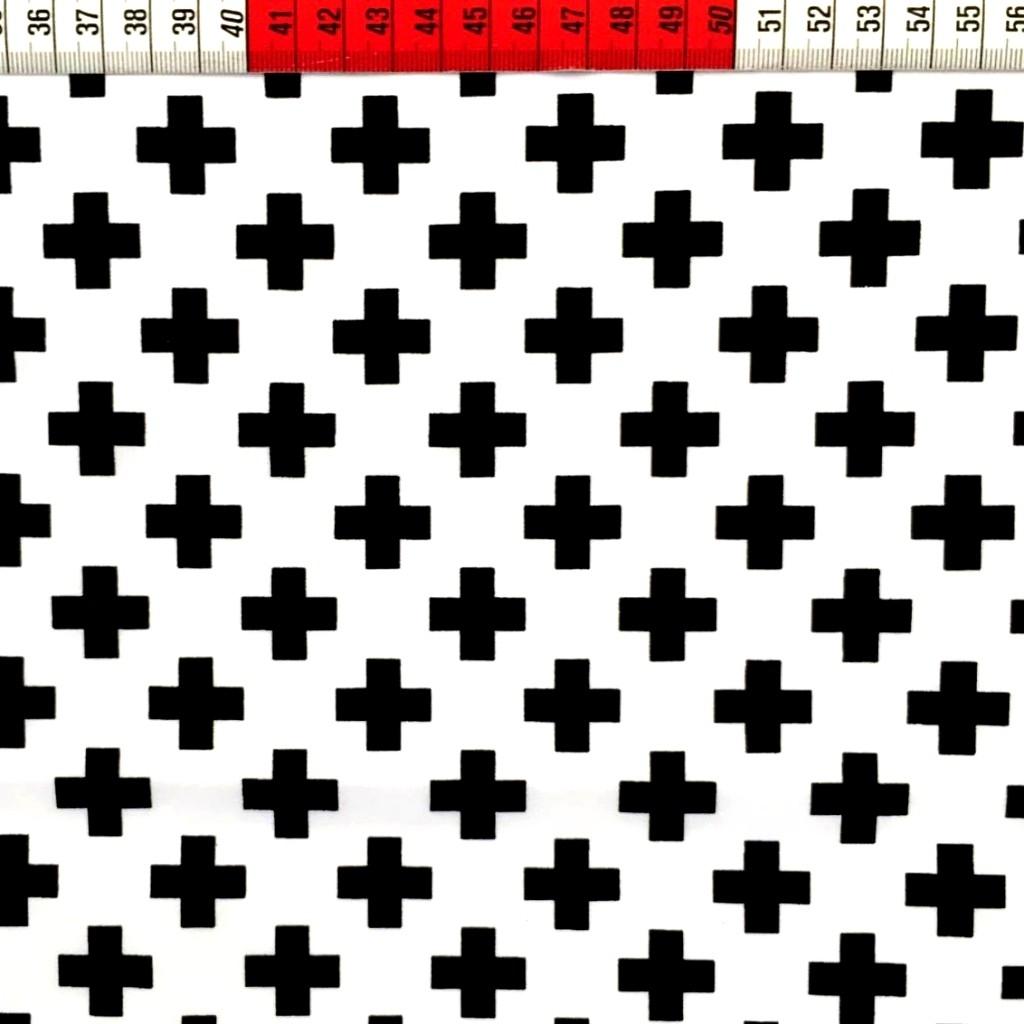 Tkanina w krzyżyki czarne na białym tle