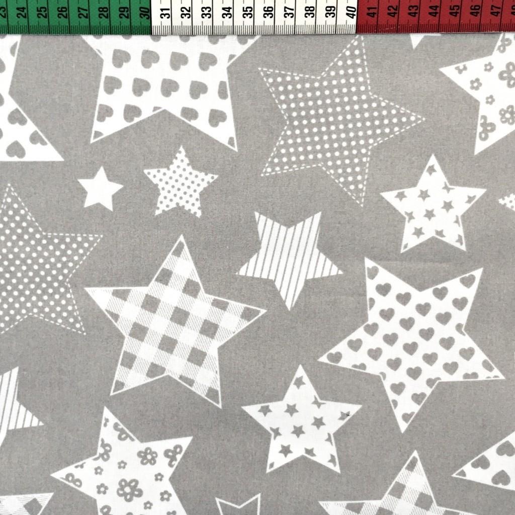 Tkanina w Gwiazdki wzorzyste na szarym tle