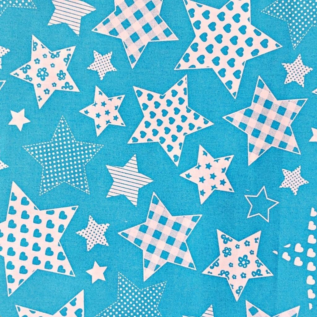 Tkanina w Gwiazdki wzorzyste na niebieskim tle