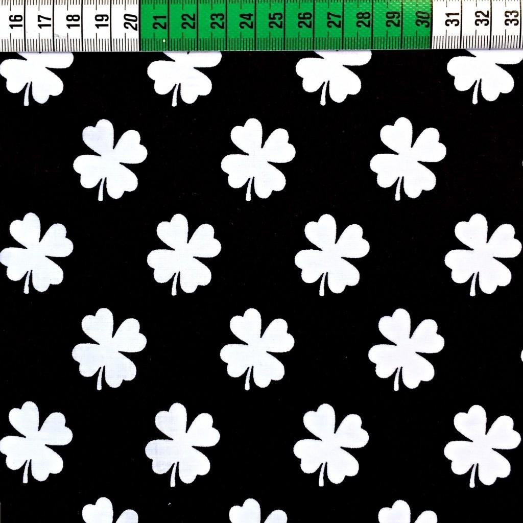 Tkanina koniczyna biała na czarnym tle