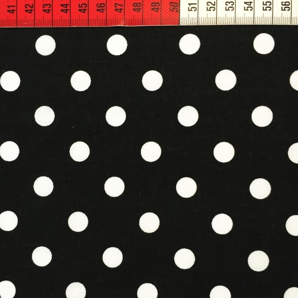 Tkanina w grochy białe na czarnym tle