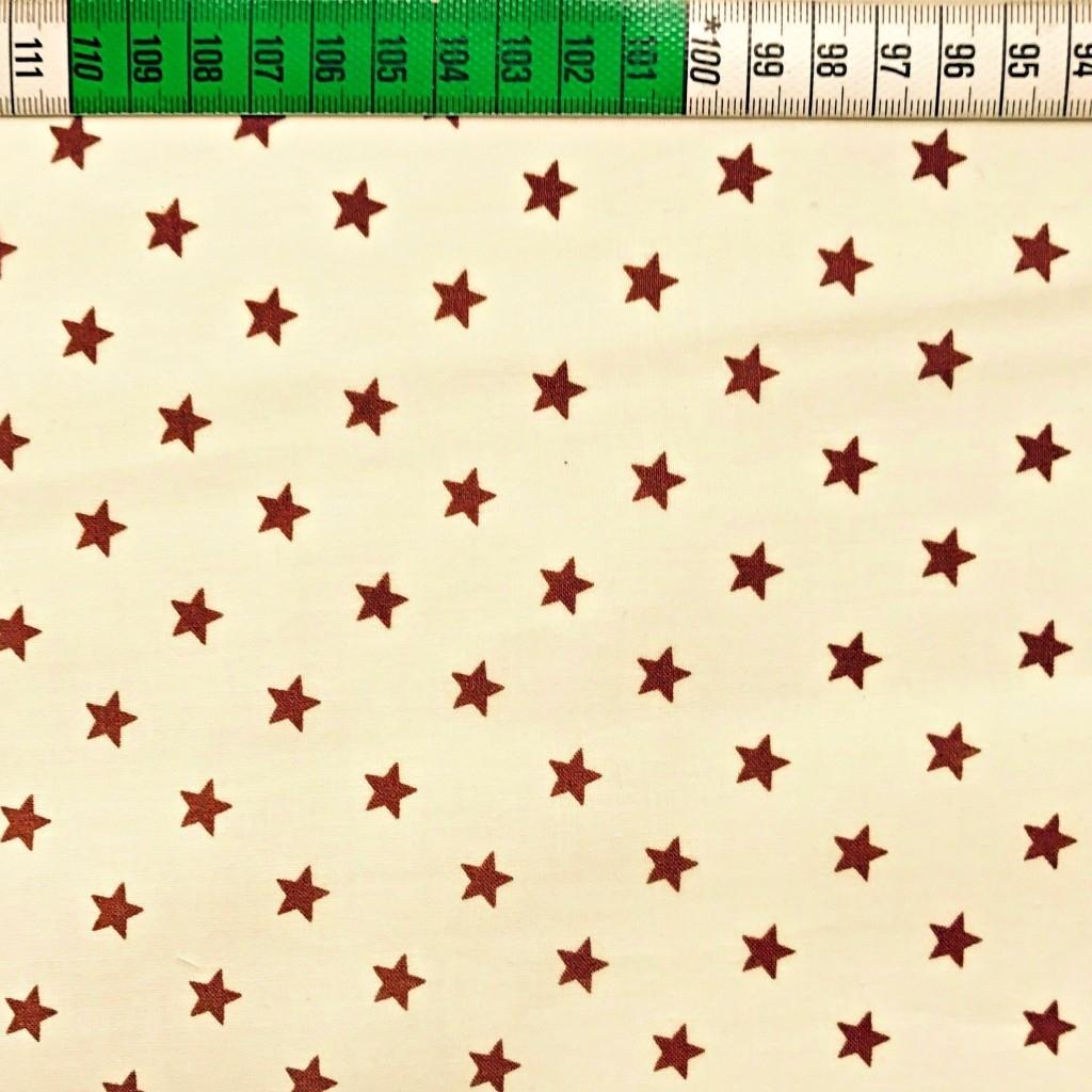 Tkanina w Gwiazdki 8mm brązowe na waniliowym tle