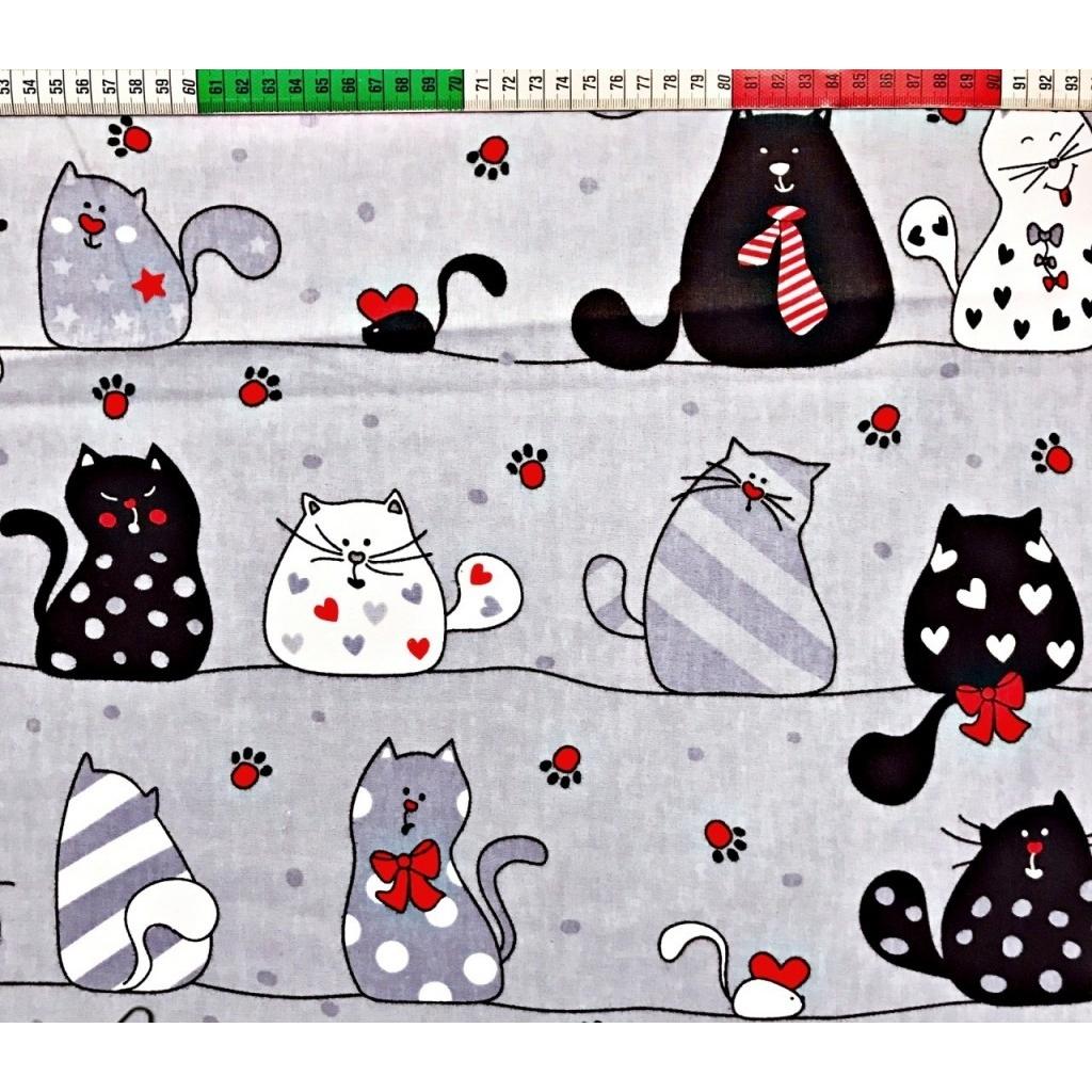 Tkanina w kotki szalone z czerwonym na szarym tle