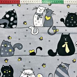 Tkanina w kotki szalone z żółtym na szarym tle