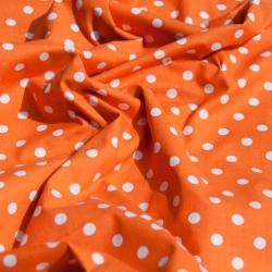 Tkanina w groszki 7mm białe na pomarańczowym tle