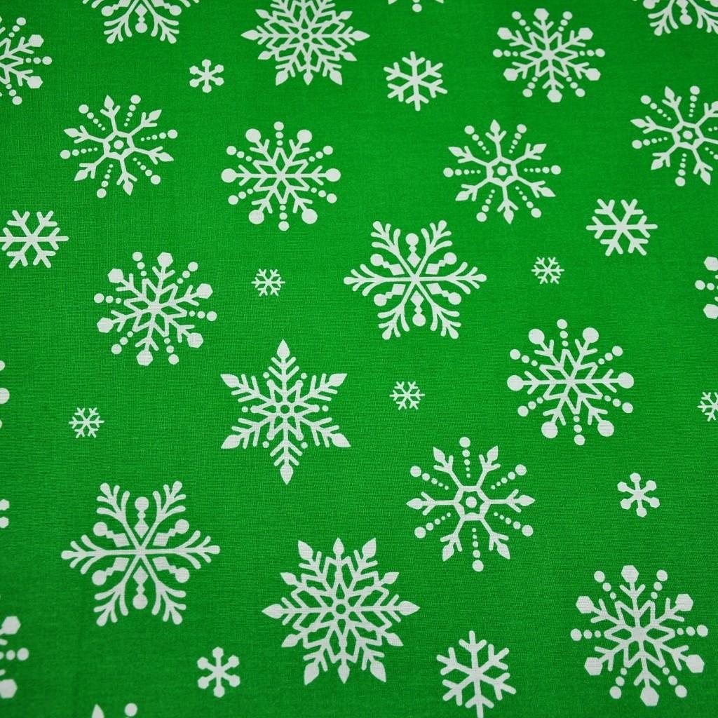 Tkanina w śnieżynki duże białe na zielonym tle