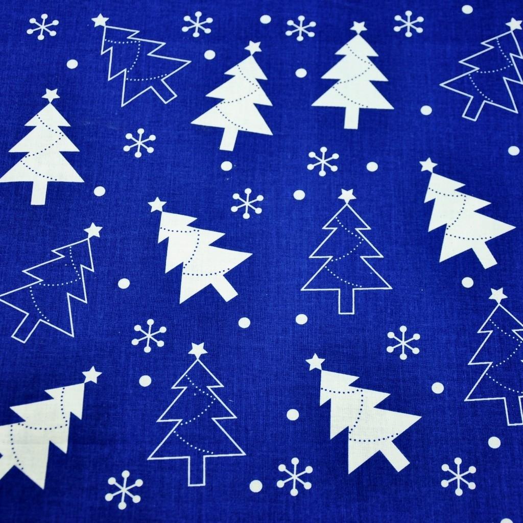 Tkanina Wzór świąteczny choinki białe na granatowym tle