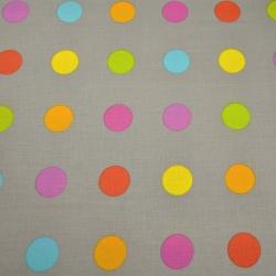 Tkanina w grochy duże kolorowe na szarym tle