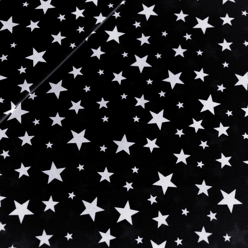 Tkanina w gwiazdki nowe małe i duże białe na czarnym tle