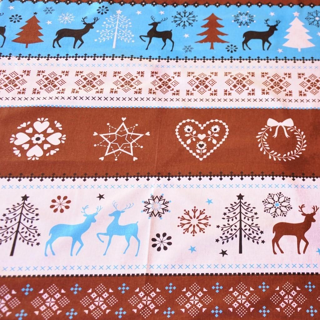 Tkanina Wzór świąteczny sweter niebiesko brązowy na białym tle