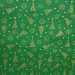 Tkanina wzór świąteczny choinki złocone i połyskujące na zielonym tle