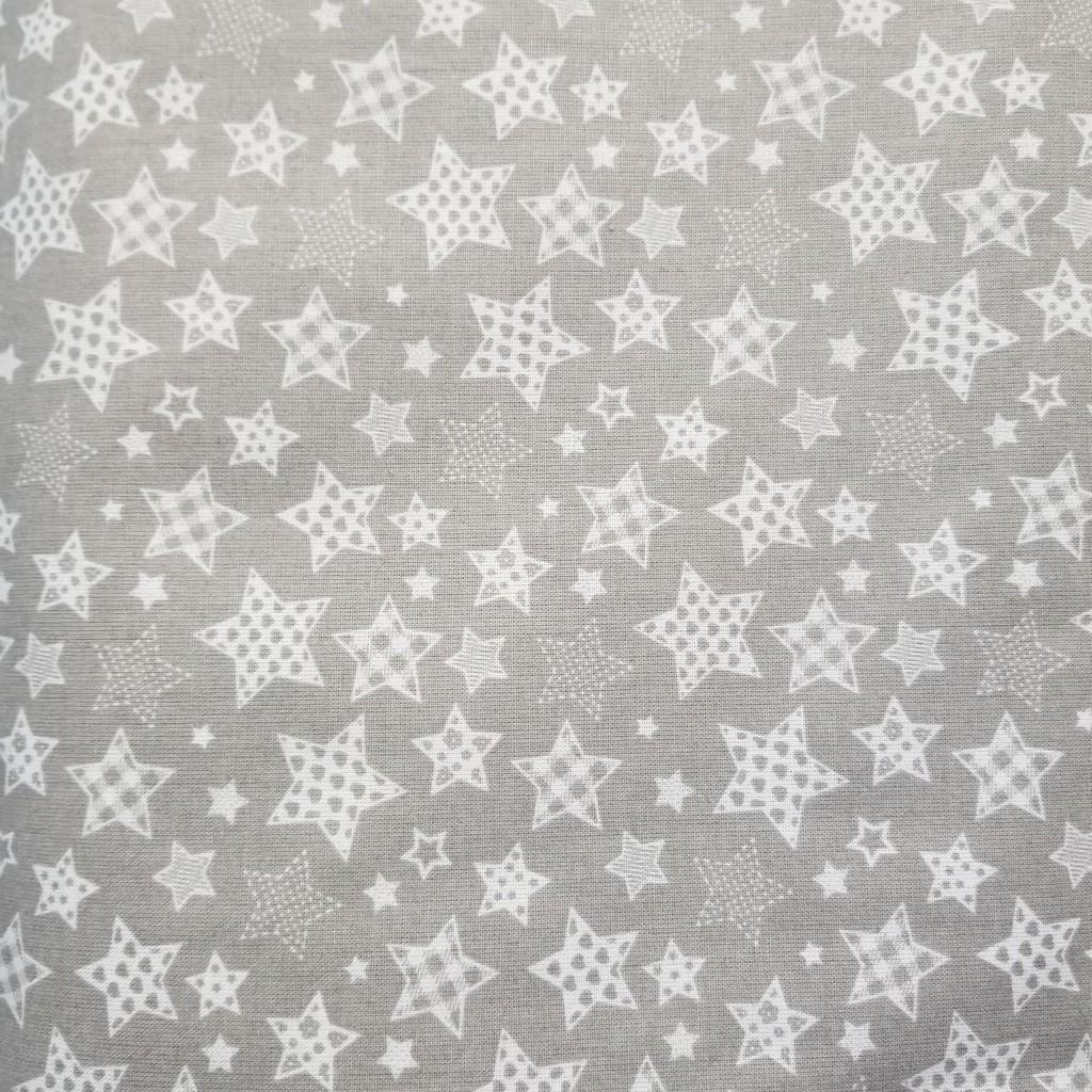 Tkanina w gwiazdki wzorzyste małe na szarym tle