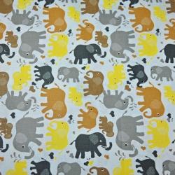 Tkanina w słonie beżowo żółte na białym tle
