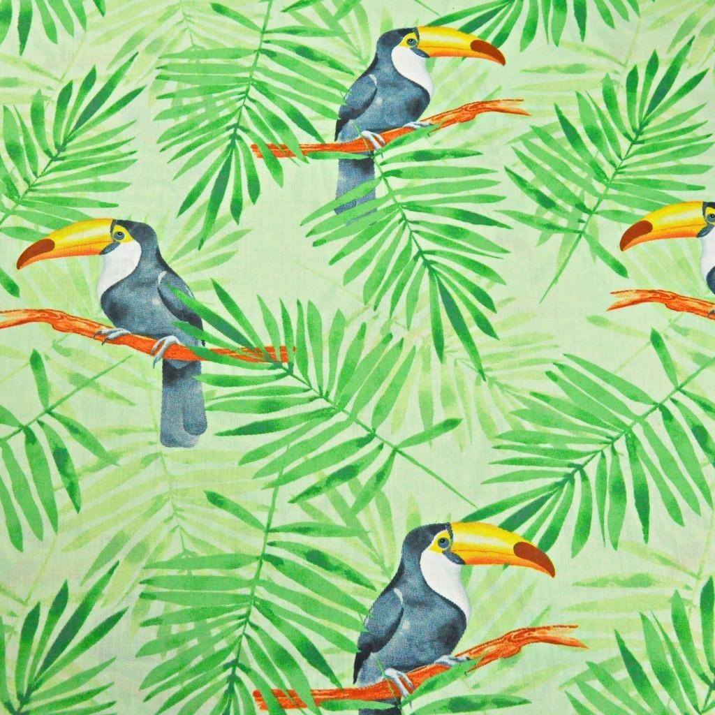 Tkanina w tukany z zielonymi liśćmi palmowymi na zielonym tle
