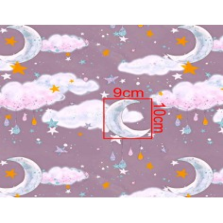 Imagén: złocona księżyce z chmurkami na fioletowym tle