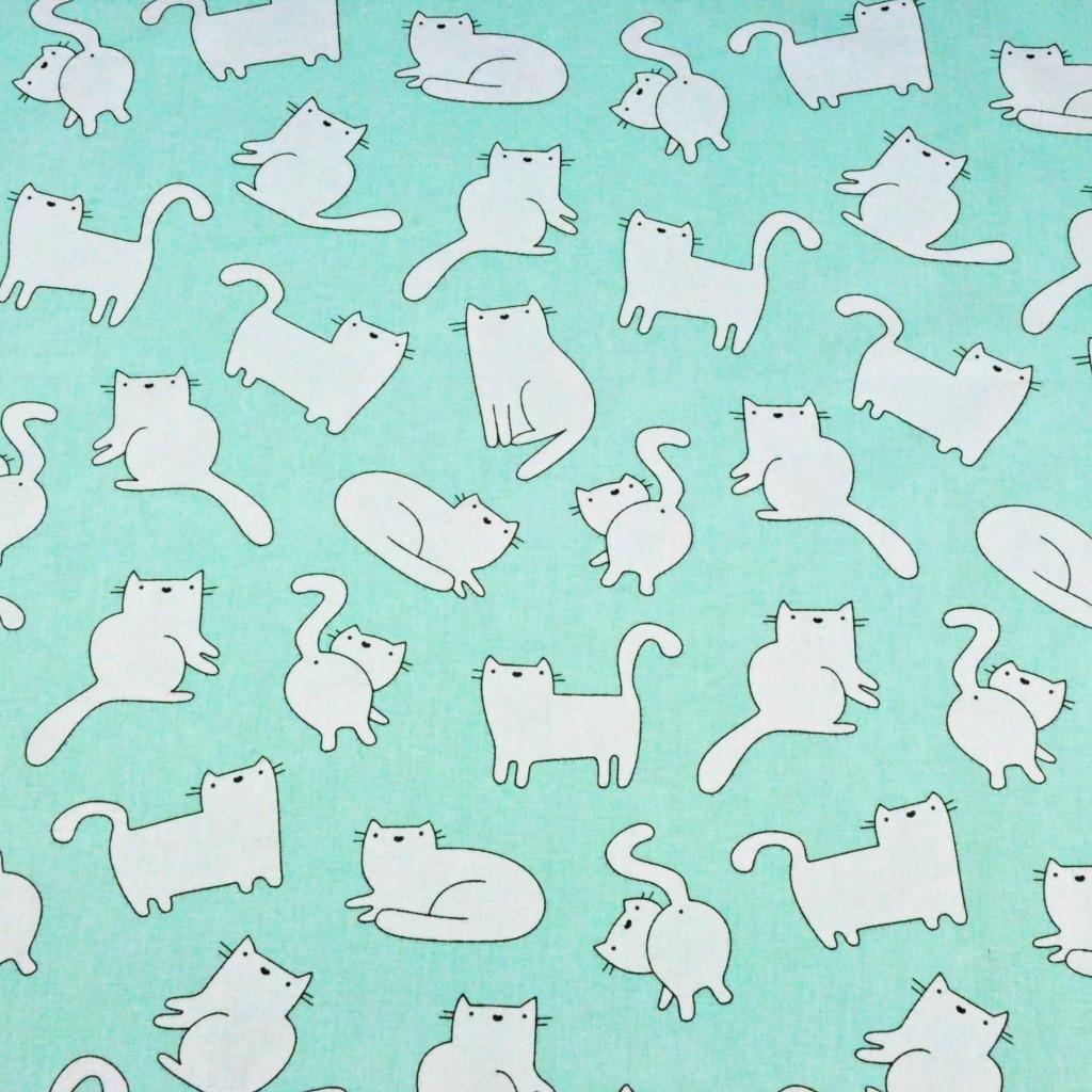 Tkanina w kotki białe na miętowym tle