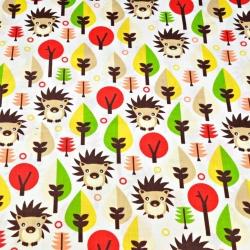 Tkanina w jeżyki i czerwone drzewka na białym tle