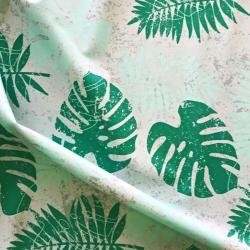 Tkanina wodoodporna zielone liście monstera na białym tle
