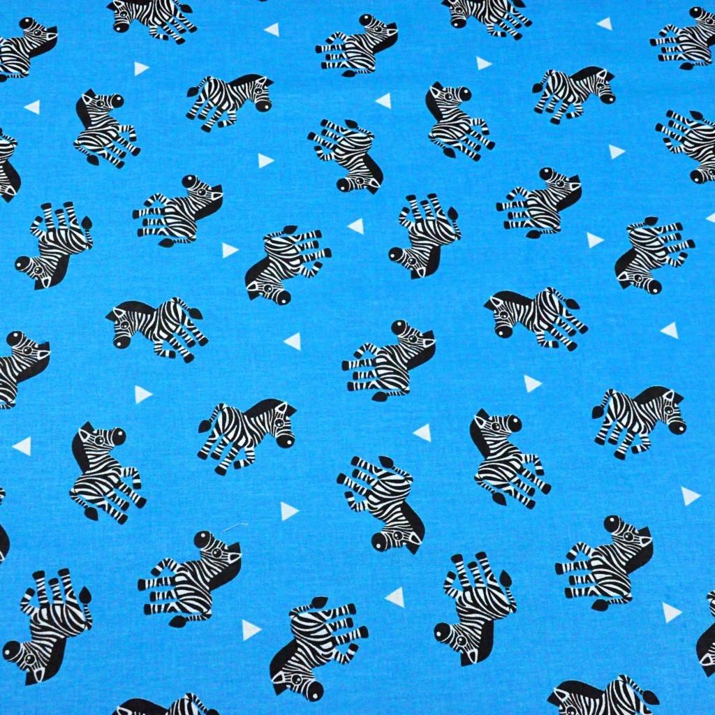 Tkanina w zebry na niebieskim tle