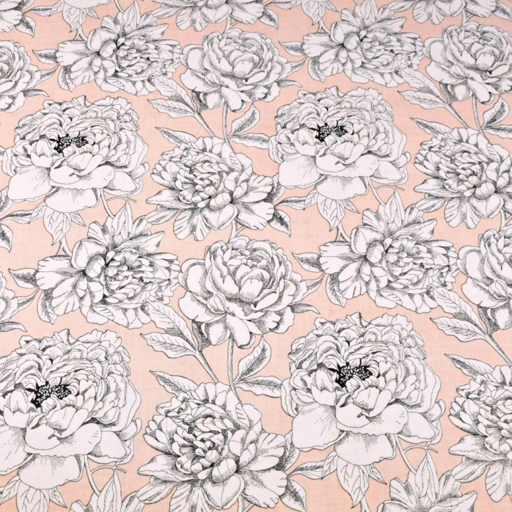 Tkanina kwiaty biało czarne na łososiowym tle